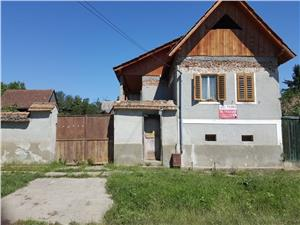 Casa libera de vanzare in Marpod